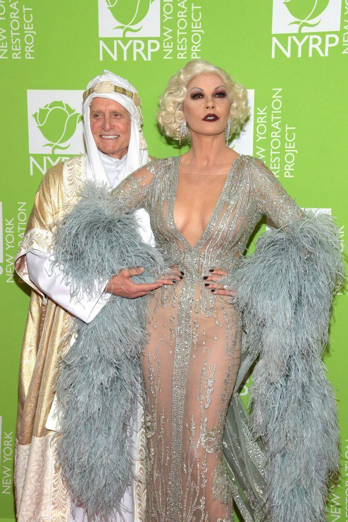 <p>This celebrity Halloween costume pair may not match but they at least feel complementary. Catherine Zeta-Jones paid tribute to Old Hollywood actress Jean Harlow, while her husband, Michael Douglas, donned robes to be Lawrence of Arabia at a charity event in 2019.</p>