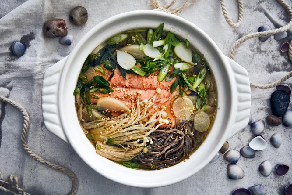 """Turnips and daikon add a subtle sweetness to this comforting, brothy meal. For the fish, you can use arctic char or salmon. <a href=""""https://www.epicurious.com/recipes/food/views/sesame-arctic-char-donabe?mbid=synd_yahoo_rss"""" rel=""""nofollow noopener"""" target=""""_blank"""" data-ylk=""""slk:See recipe."""" class=""""link rapid-noclick-resp"""">See recipe.</a>"""