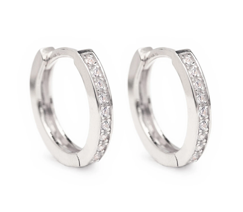 "<h3><a href=""https://amyojewelry.com/collections/hoop-huggie-earrings/products/classic-pave-huggie-hoops-silver"" rel=""nofollow noopener"" target=""_blank"" data-ylk=""slk:Amy O Classic Pave Huggie Hoops"" class=""link rapid-noclick-resp"">Amy O Classic Pave Huggie Hoops</a></h3><br>Whatever her personal style, these understated and delicate, hypoallergenic huggie hoops are guaranteed to please. <br><br><strong>Amy O Jewelry</strong> Classic Pave Huggie Hoops, $, available at <a href=""https://go.skimresources.com/?id=30283X879131&url=https%3A%2F%2Famyojewelry.com%2Fcollections%2Fhoop-huggie-earrings%2Fproducts%2Fclassic-pave-huggie-hoops-silver"" rel=""nofollow noopener"" target=""_blank"" data-ylk=""slk:Amy O"" class=""link rapid-noclick-resp"">Amy O</a>"