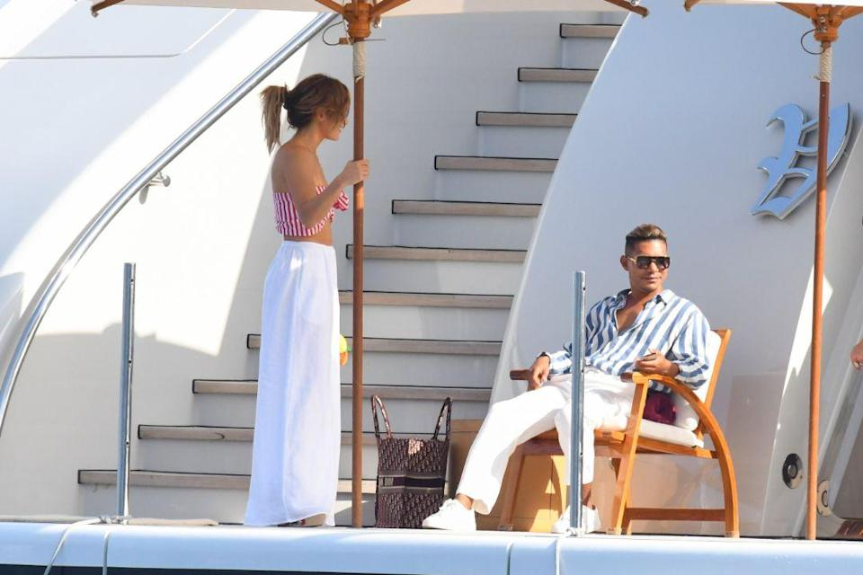 Jennifer Lopez and a friend on a yacht in the Amalfi Coast, Italy, July 28. - Credit: MEGA