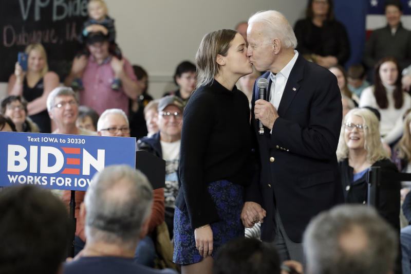 Joe Biden raised a few eyebrows during his Iowa campaign event by kissing his granddaughter on the lips. Source: AP