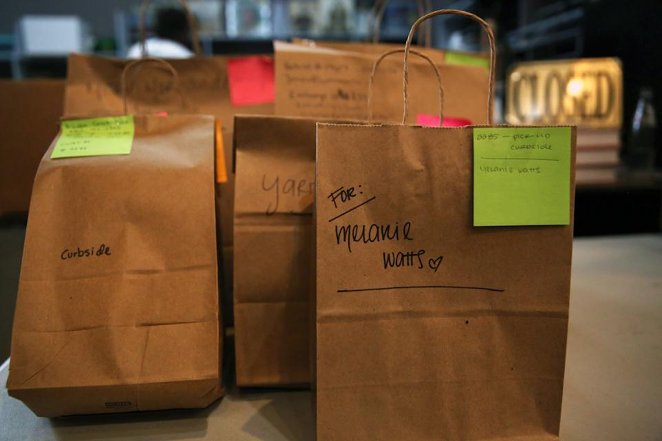 """In May, books were bagged and ready for curbside customer pickup at the Last Bookstore in downtown L.A. <span class=""""copyright"""">(Dania Maxwell / Los Angeles Times)</span>"""