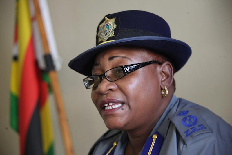 Zimbabwean Police spokesperson, Assistant Commissioner Charity Charamba, addresses a press conference in Harare, Sunday, March, 17, 2013, following the arrests of one of the country's top human rights lawyer, Beatrice Mtetwa who was arrested while questioning the police over the arrests of top aides of Prime Minister Morgan Tsvangirai. Charamba was quoted as saying that Mtetwa was interfering with Police investigations (AP Photo/Tsvangirayi Mukwazhi)