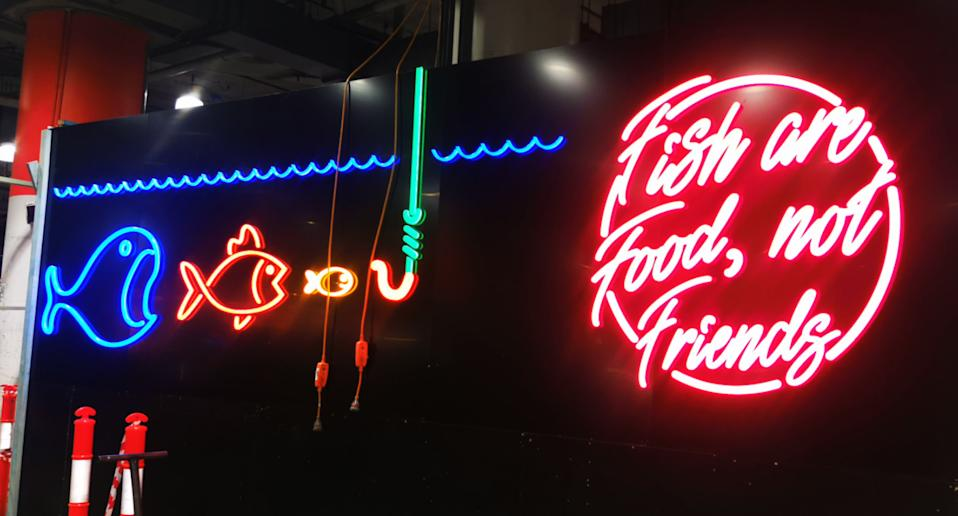 Photo shows sign saying 'fish are food, not friends' inside Sydney's Paddy's Markets.