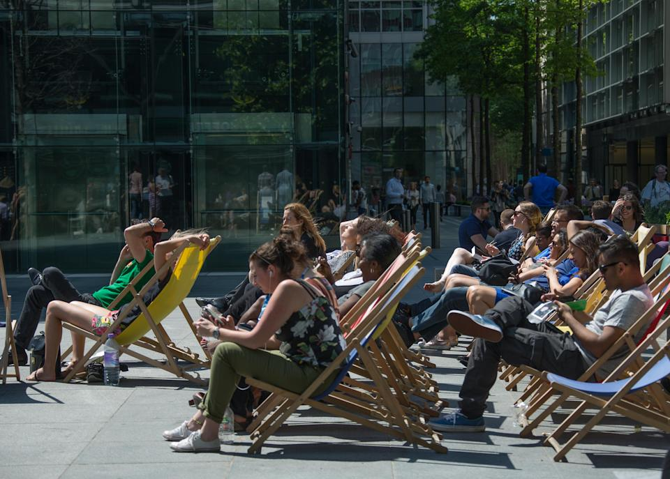 Office workers in London take a lunch break in the sun. Picture: Richard Gray/EMPICS Entertainment