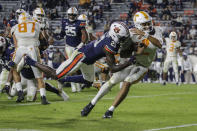Tennessee quarterback Jarrett Guarantano (2) caries the ball in for a touchdown as Auburn defensive back Smoke Monday (21) tries to stop him during the first half of an NCAA college football game Saturday, Nov. 21, 2020, in Auburn, Ala. (AP Photo/Butch Dill)