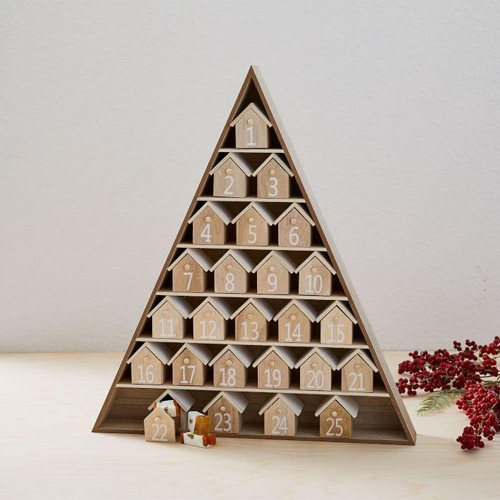 "<p><a href=""https://www.popsugar.com/buy/House-Advent-Calendar-513690?p_name=House%20Advent%20Calendar&retailer=westelm.com&pid=513690&price=63&evar1=moms%3Aus&evar9=46865966&evar98=https%3A%2F%2Fwww.popsugar.com%2Fphoto-gallery%2F46865966%2Fimage%2F46867650%2FHouse-Advent-Calendar&prop13=api&pdata=1"" rel=""nofollow"" data-shoppable-link=""1"" target=""_blank"" class=""ga-track"" data-ga-category=""Related"" data-ga-label=""https://www.westelm.com/products/house-advent-calendar-d6560/?catalogId=71&amp;sku=9392147&amp;cm_ven=PLA&amp;cm_cat=Google&amp;cm_pla=Holidays%20%3E%20Holiday%20Decor%20%2B%20Pillows&amp;cm_ite=9392147&amp;gclid=EAIaIQobChMIhYzYqOfY5QIVD__jBx0uXwyAEAQYBCABEgLg2PD_BwE"" data-ga-action=""In-Line Links"">House Advent Calendar</a> ($63, originally $79)</p>"