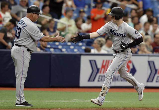 Miami Marlins' Brian Anderson, right, shakes hands with third base coach Fredi Gonzalez after hitting a solo home run off Tampa Bay Rays relief pitcher Yonny Chirinos during the fourth inning of a baseball game Sunday, Aug. 4, 2019, in St. Petersburg, Fla. (AP Photo/Chris O'Meara)