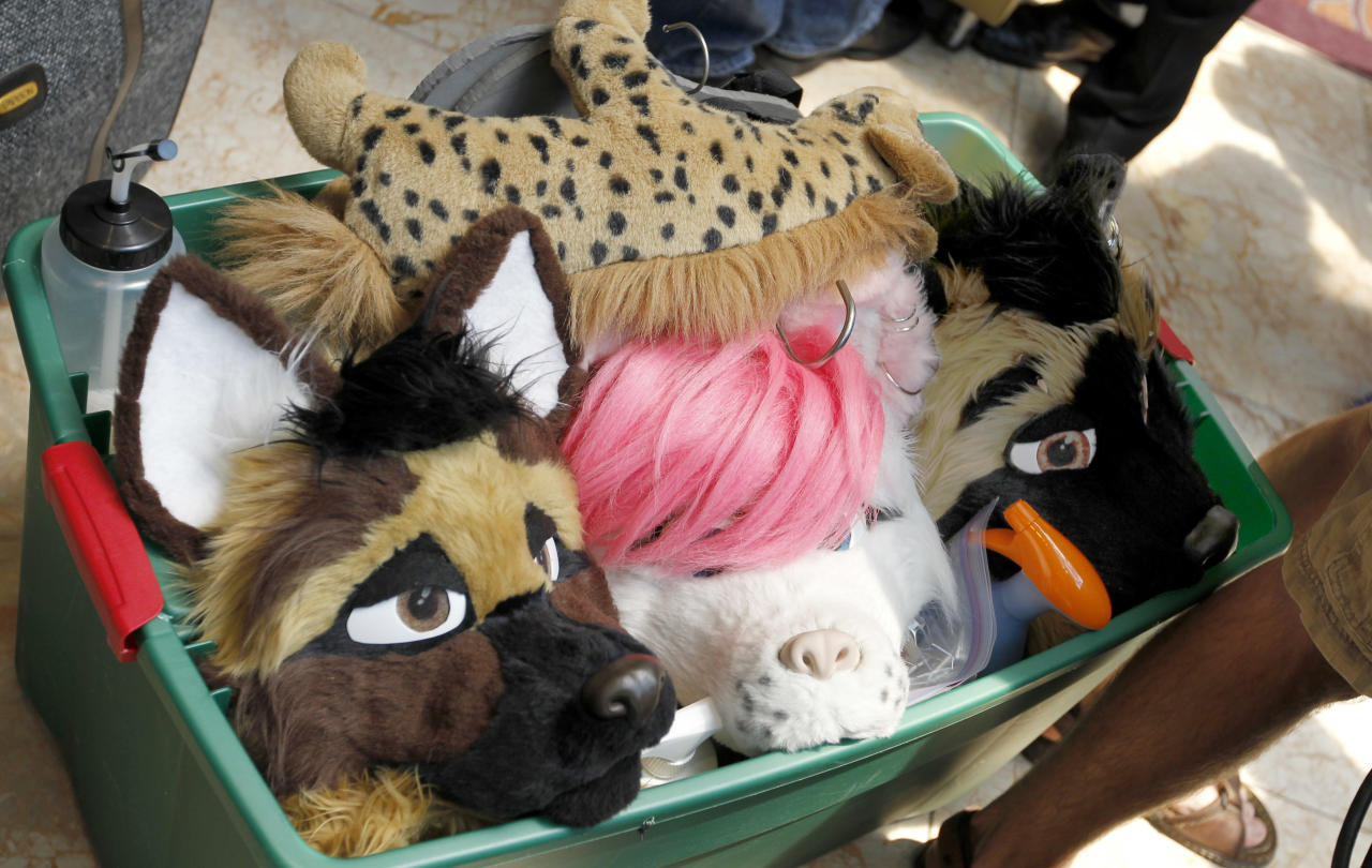 In this photo made on Thursday, June 14, 2012, visitors attending Anthrocon move a container with costume parts through the lobby of the Westin Convention Center hotel in Pittsburgh. Anthrocon, the world's largest convention for people who dress and assume the rolls of fictional animal characters, is back in its adopted home with an expected 5,000 participants between June 14 to 17, 2012. (AP Photo/Keith Srakocic)