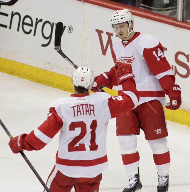 Detroit Red Wings center Gustav Nyquist, right, of Sweden is congratulated by teammate Tomas Tatar of Czech Republic, after scoring against the Minnesota Wild during the third period of an NHL hockey game, Saturday, March 22, 2014, in St. Paul, Minn. Detroit won 3-2. (AP Photo/Paul Battaglia)