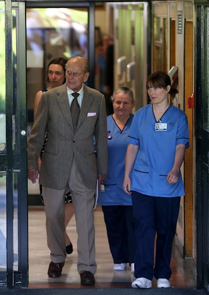 Britain's Prince Philip leaves Aberdeen Royal Infirmary, Aberdeen, Scotland Monday Aug. 20, 2012 after five days of treatment for a bladder infection. The 91-year-old husband of Queen Elizabeth II was hospitalized Wednesday with a recurrence of an infection he suffered earlier this summer. Buckingham Palace said Philip was discharged from Aberdeen Royal Infirmary in northeast Scotland was returning to the nearby Balmoral estate, where the royal family is on vacation. (AP Photo/Andrew Milligan/PA Wire) UNITED KINGDOM OUT