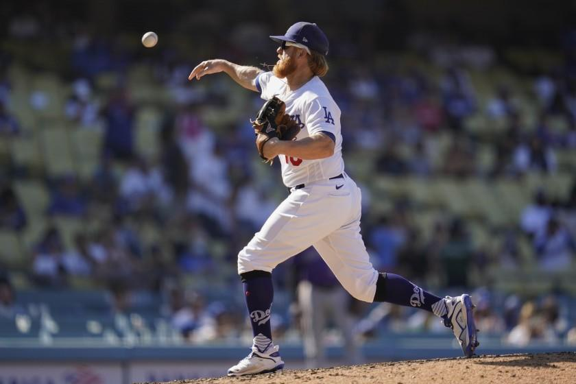Los Angeles Dodgers relief pitcher Justin Turner throws during the ninth inning.