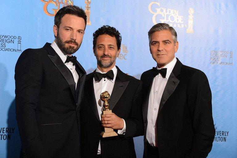 """Actor/director Ben Affleck (left) and producers Grant Heslov (centre) and George Clooney with the award for best motion picture drama for """"Argo"""" at the Golden Globes awards ceremony in Beverly Hills on January 13, 2013. Iran is to make its own movie about the American hostage drama during the 1979 Islamic revolution to counter the """"distorted"""" film """"Argo."""""""