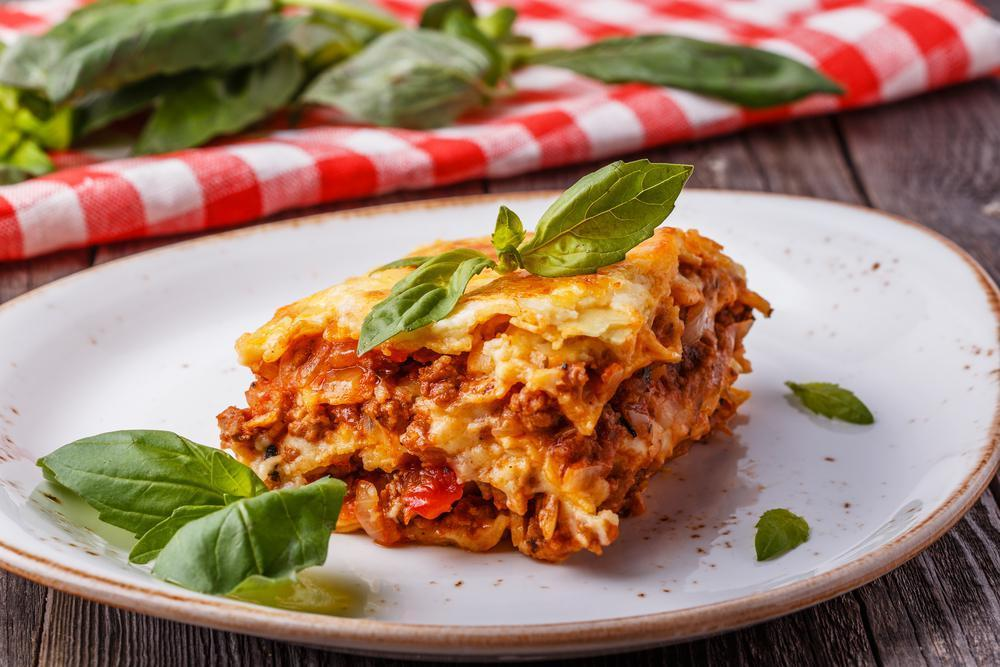 """<p>Lasagna is cheesy, hearty and full of carbs — all in all very comforting. And it is so handy on lazy weeknights to have a ready-made pan in the freezer waiting to be baked and devoured. This classic recipe, appropriately named <a href=""""https://www.thedailymeal.com/recipes/grandmas-lasagna-recipe-0?referrer=yahoo&category=beauty_food&include_utm=1&utm_medium=referral&utm_source=yahoo&utm_campaign=feed"""">""""Grandma's Lasagna,""""</a> will scoop you up in the warmest, most delicious hug.</p>"""