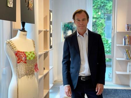 FILE PHOTO: H&M Chief Executive Karl-Johan Persson poses for a picture at the fashion retailer's headquarters in Stockholm