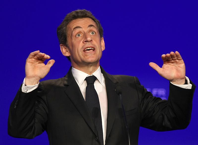 France's President and candidate for the Presidential Election 2012, Nicolas Sarkozy, delivers his speech during a campaign meeting, in Nimes, southern France, Thursday, March 29, 2012. (AP Photo/Claude Paris)