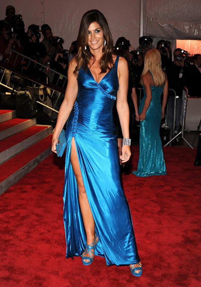 """Supermodel Cindy Crawford electrified the red carpet in a daring Versace gown, which she paired with strappy platform sandals. Kevin Mazur/<a href=""""http://www.wireimage.com"""" target=""""new"""">WireImage.com</a> - May 4, 2009"""
