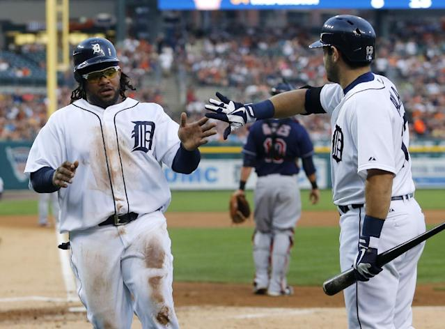Detroit Tigers' Prince Fielder, left, gets a high-five from Alex Avila after scoring on a sacrifice fly ball by Don Kelly in the second inning of a baseball game against the Cleveland Indians, Friday, Aug. 30, 2013, in Detroit. (AP Photo/Duane Burleson)