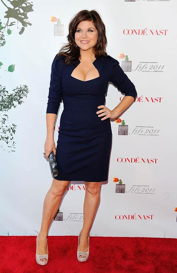 "Following in Fergie's footsteps was ""Saved By the Bell"" and ""Beverly Hills 90210"" alum Tiffani Thiessen, who looked lovely while popping a pose in her regal Roland Moret dress. Andrew H. Walker/<a href=""http://www.gettyimages.com/"" target=""new"">GettyImages.com</a> - May 25, 2011"