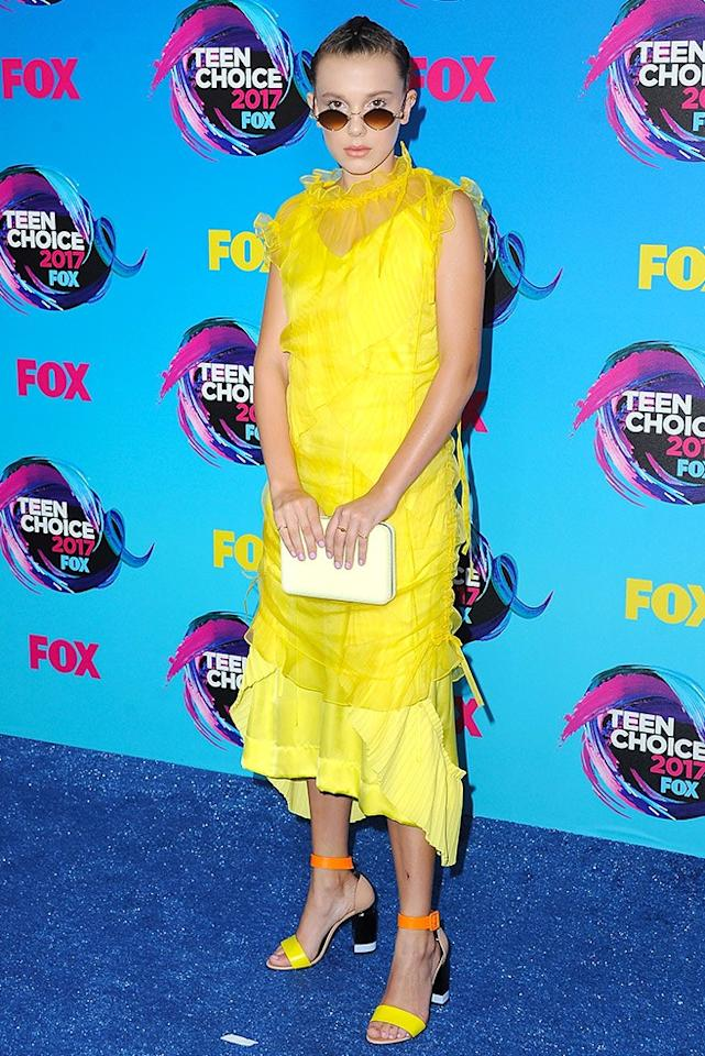 <p>The 13-year-old actress seriously upped her fashion game in a vibrant yellow dress by Kenzo.<br /><i>[Photo: Getty]</i> </p>