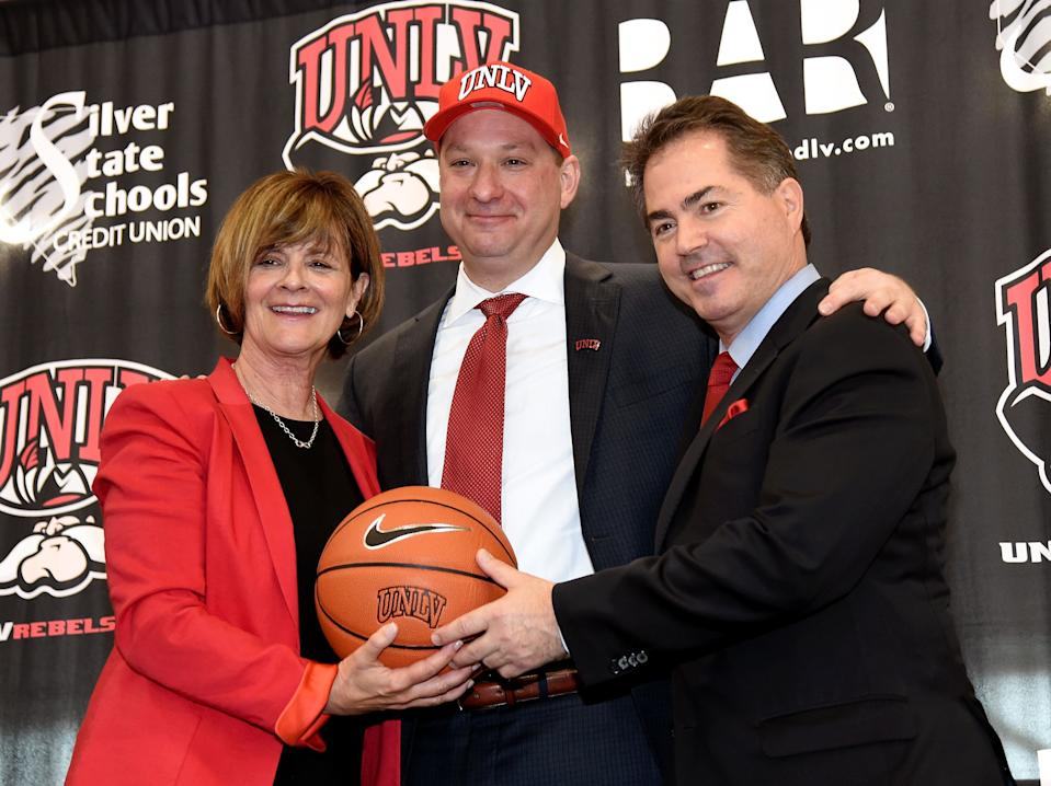 LAS VEGAS, NEVADA - APRIL 08:  (L-R) UNLV athletics director Tina Kunzer-Murphy, Chris Beard and UNLV President Len Jessup pose after Beard was introduced as UNLV's new head basketball coach at a news conference at the Mendenhall Center at UNLV on April 8, 2016 in Las Vegas, Nevada.  (Photo by Ethan Miller/Getty Images)