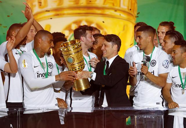 Soccer Football - DFB Cup Final - Bayern Munich vs Eintracht Frankfurt - Olympiastadion, Berlin, Germany - May 19, 2018 Eintracht Frankfurt coach Niko Kovac, Kevin-Prince Boateng and team mates celebrate with the trophy after winning the DFB Cup REUTERS/Kai Pfaffenbach DFB RULES PROHIBIT USE IN MMS SERVICES VIA HANDHELD DEVICES UNTIL TWO HOURS AFTER A MATCH AND ANY USAGE ON INTERNET OR ONLINE MEDIA SIMULATING VIDEO FOOTAGE DURING THE MATCH.