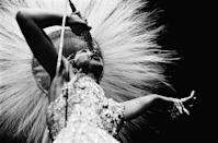 <p>Here, Baker performs at The Olympia in Miami, Florida in a beaded, sequined gown and a feathered headdress for the ages. <br></p>