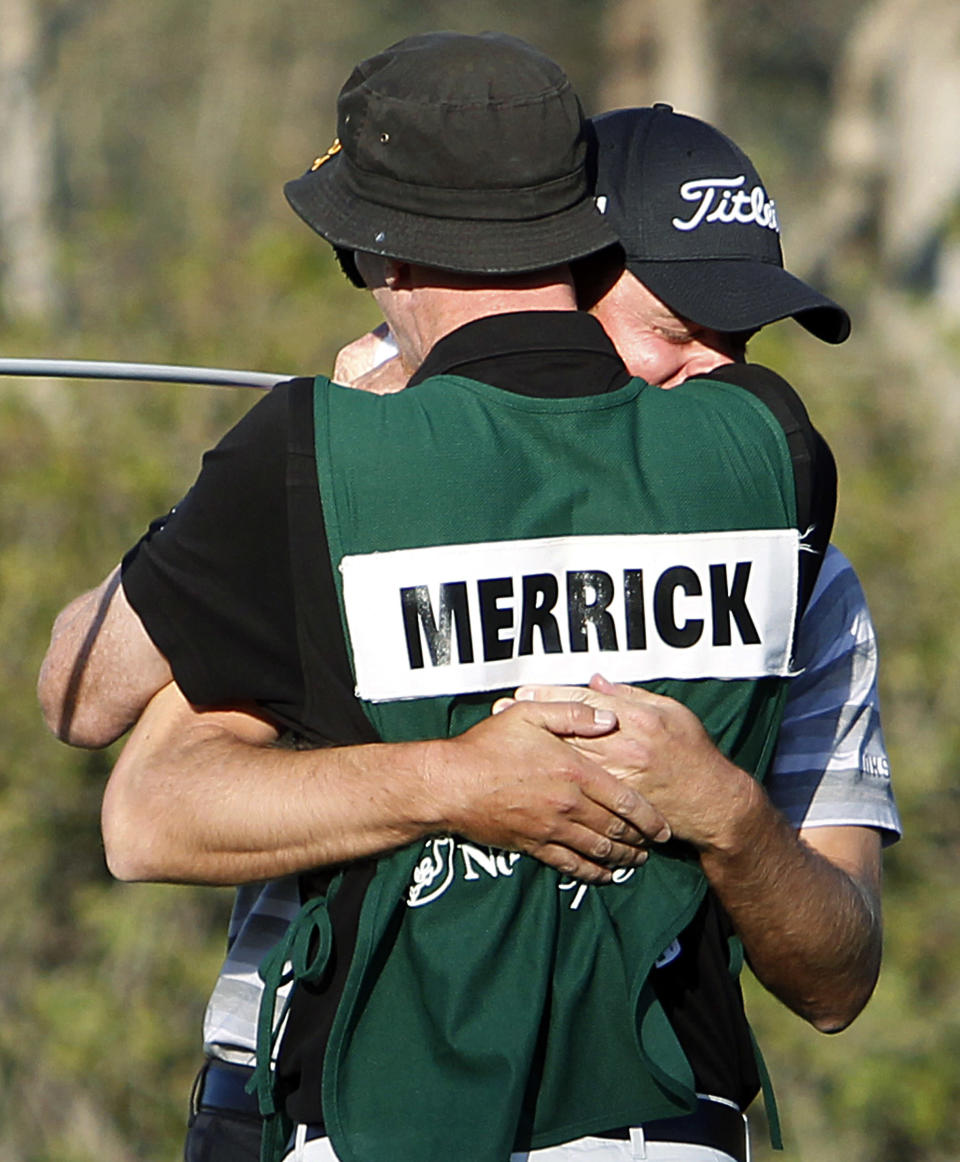 John Merrick, rear, and his caddie Ryan Goble embrace after Merrick's victory in the Northern Trust Open golf tournament at Riviera Country Club in the Pacific Palisades area of Los Angeles, Sunday, Feb. 17, 2013. Merrick hit two clutch shots that led to two pars in a sudden-death playoff to win the tournament. (AP Photo/Reed Saxon)