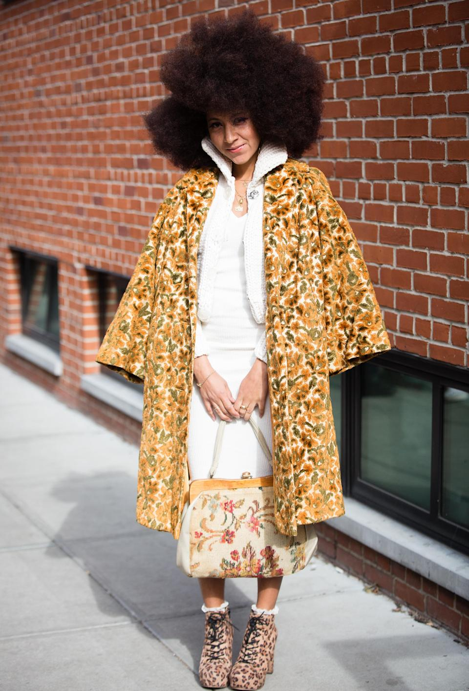 <p>A guest poses outside the Lanyu show wearing a floral jacket and a white dress. <em>[Photo: Getty]</em> </p>