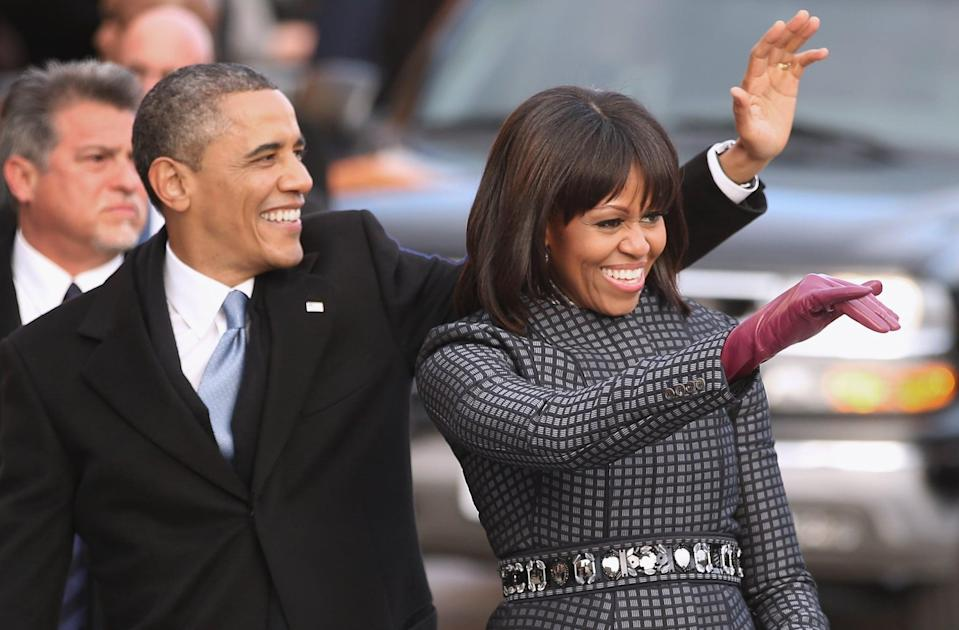 WASHINGTON, DC - JANUARY 21:  U.S. President Barack Obama and first lady Michelle Obama wave to supporters as they walk the inaugural parade route down Pennsylvania Avenue January 21, 2013 in Washington, DC. President Obama took the oath of office earlier in the day during a ceremony on the west front of the U.S. Capitol.  (Photo by Chip Somodevilla/Getty Images)