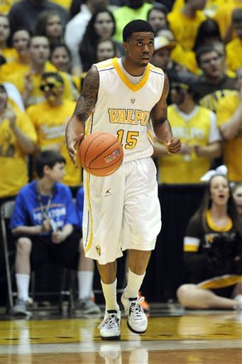 Valparaiso guard Erik Buggs heads up court during during the first half of an NCAA college basketball game in the final of Horizon League Conference tournament Tuesday March 12, 2013 in Valparaiso, Ind. (AP Photo/Joe Raymond)