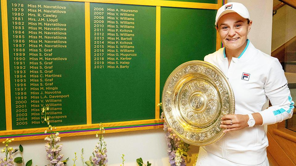 Ash Barty, pictured here in front of the Ladies' Singles Winner's Board at Wimbledon.