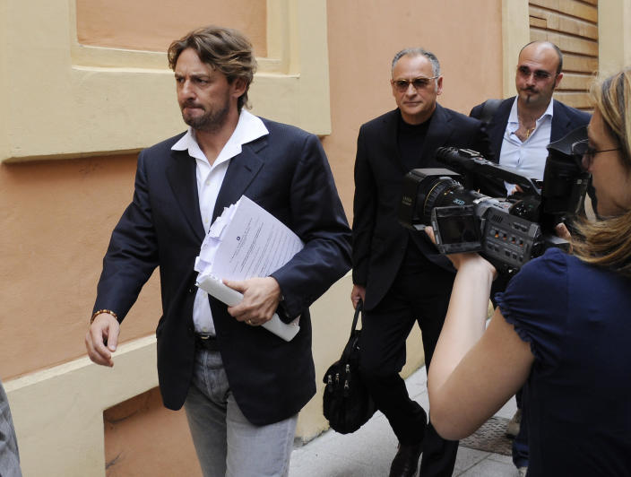 """FILE - In this Wednesday, June 8, 2011 file photo Giuseppe Signori, left, arrives at the Cremona court, Italy. Signori was among those arrested in """"Operation Last Bet"""", a case overseen by Italian prosecutor Roberto Di Martino in the town of Cremona. (AP Photo/Antonio Calanni)"""