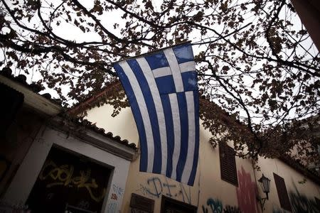 A Greek national flag flutters in the wind at the Plaka district in Athens