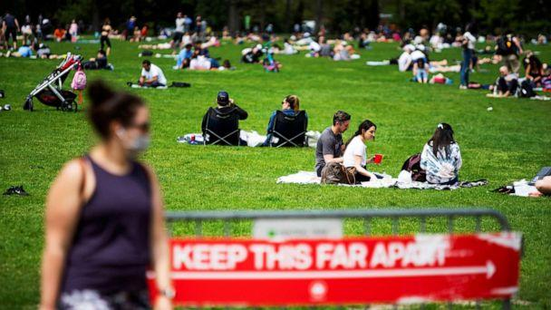 PHOTO: People enjoy Central Park while maintaining social distancing norms, during the coronavirus pandemic, in the Manhattan borough of New York City, May 2, 2020. (Eduardo Munoz/Reuters)