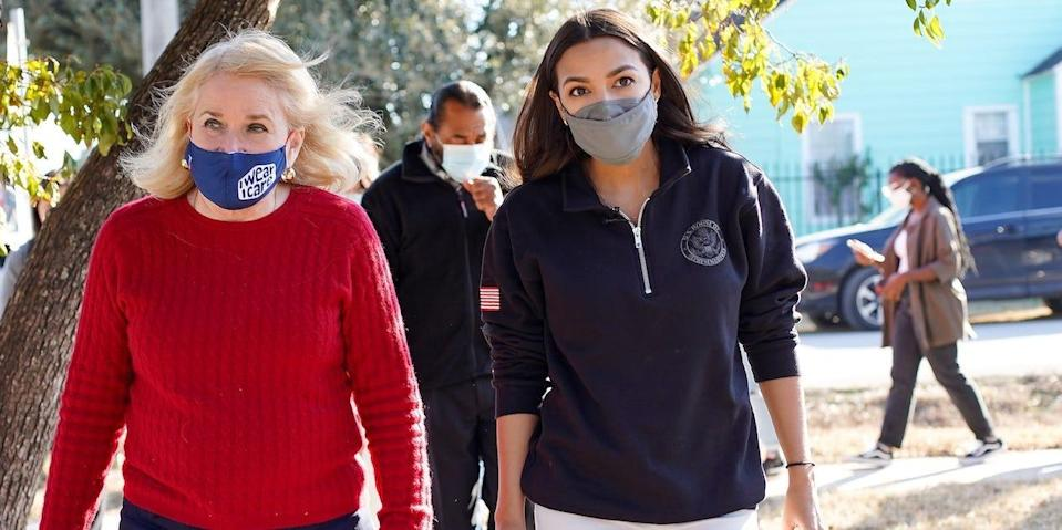 U.S. Rep. Alexandria Ocasio-Cortez visits homes that were damaged by the winter storm in Houston.