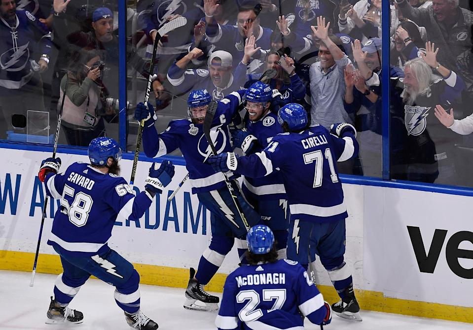 Tampa Bay Lightning left wing Ross Colton celebrates his second-period goal with teammates.