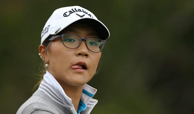 Lydia Ko reacts after her fairway shot on the third hole in the final round of the Manulife Financial LPGA Classic golf tournament Sunday, June 8, 2014, in Waterloo, Ontario. (AP Photo/The Canadian Press, Dave Chidley)