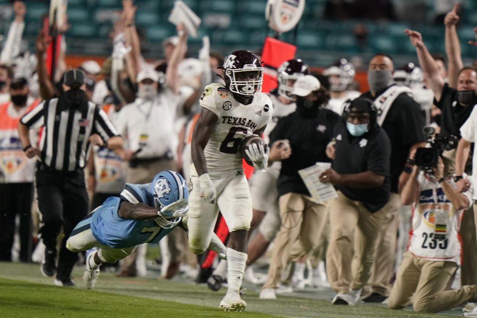 Texas A&M running back Devon Achane (6) runs for a touchdown during the second half of the Orange Bowl NCAA college football game, Saturday, Jan. 2, 2021, in Miami Gardens, Fla. Texas A&M defeated North Carolina 41-27. (AP Photo/Lynne Sladky)