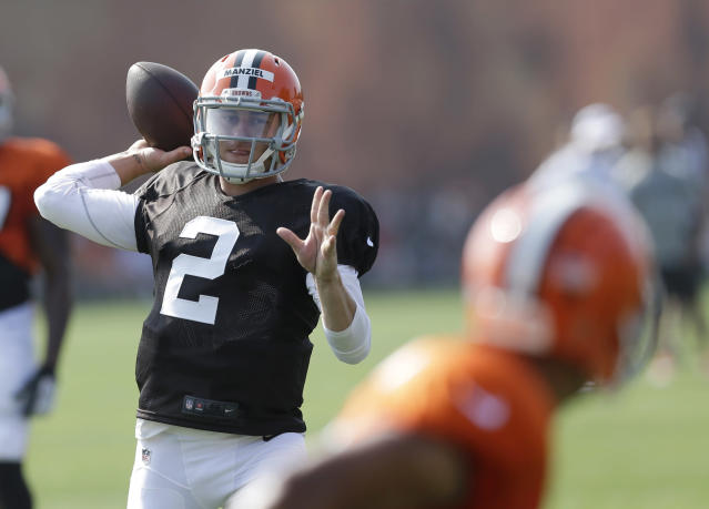 Cleveland Browns quarterback Johnny Manziel throws a pass during practice at the NFL football team's training camp Monday, Aug. 4, 2014, in Berea, Ohio. Manziel has taken his first snaps in training camp with Cleveland's starters. Manziel is trying to beat out Brian Hoyer for the starting job. The former Heisman Trophy winner from Texas A&M had worked exclusively with Cleveland's second-string offense until Monday. (AP Photo/Tony Dejak)