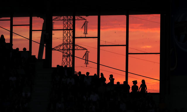 Spectators watch the Women's World Cup round of 16 soccer match between the Netherlands and Japan at Roazhon Park as the sunsets, in Rennes, France, Tuesday, June 25, 2019. (AP Photo/Francois Mori)