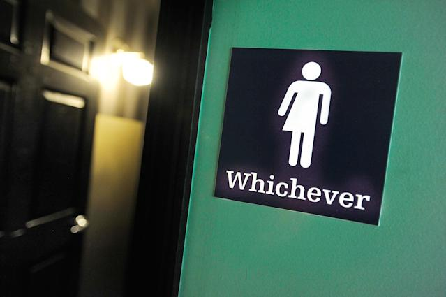 A gender neutral sign is posted outside a bathroom in Durham, N.C., in 2016. (Photo: Sara D. Davis/Getty Images)
