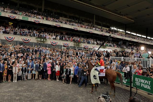 Jockey Mike Smith celebrates in the winner's circle aboard Justify after winning the 150th running of the Belmont Stakes, the third leg of the Triple Crown of Thoroughbred Racing at Belmont Park in Elmont, New York, U.S., June 9, 2018. REUTERS/Lucas Jackson