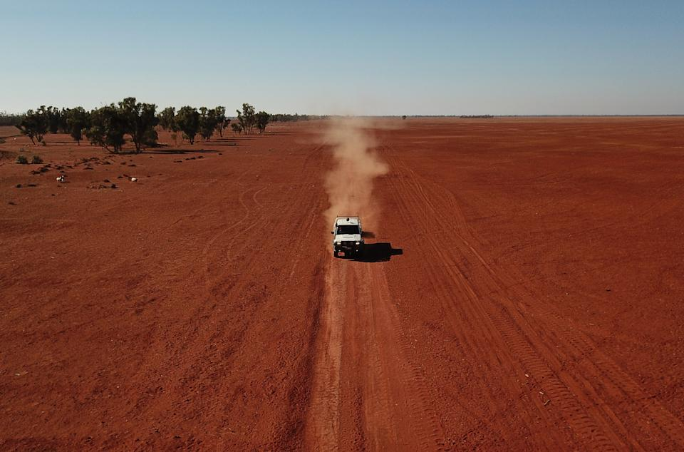 Grazier Scott Todd drives through his drought affected property during a stock feed run near Bollon in southwest Queensland. Source: AAP