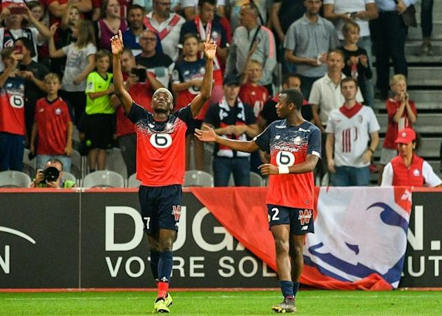 Smaller clubs, like French Ligue 1 outfit Lille, could have their route to the Champions League blocked by the reforms, according to the plan's opponents (AFP Photo/PHILIPPE HUGUEN)