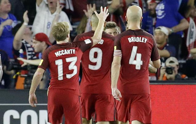 Dax McCarty (13) celebrates with teammates in Orlando, which is near where he grew up. (AP)