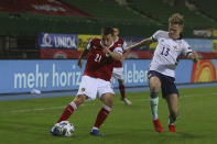 Austria's Stefan Lainer, left, is challenged by Northern Ireland's Alistair Edward McCann during the UEFA Nations League soccer match between Austria and Northern Ireland at the Ernst-Happel stadium in Vienna, Austria, Sunday, Nov. 15, 2020. (AP Photo/Ronald Zak)