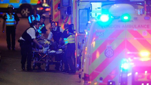 PHOTO: Police officers and members of the emergency services attend to a person injured in an incident on London Bridge in central London on June 3, 2017. (Daniel Sorabji/AFP/Getty Images)