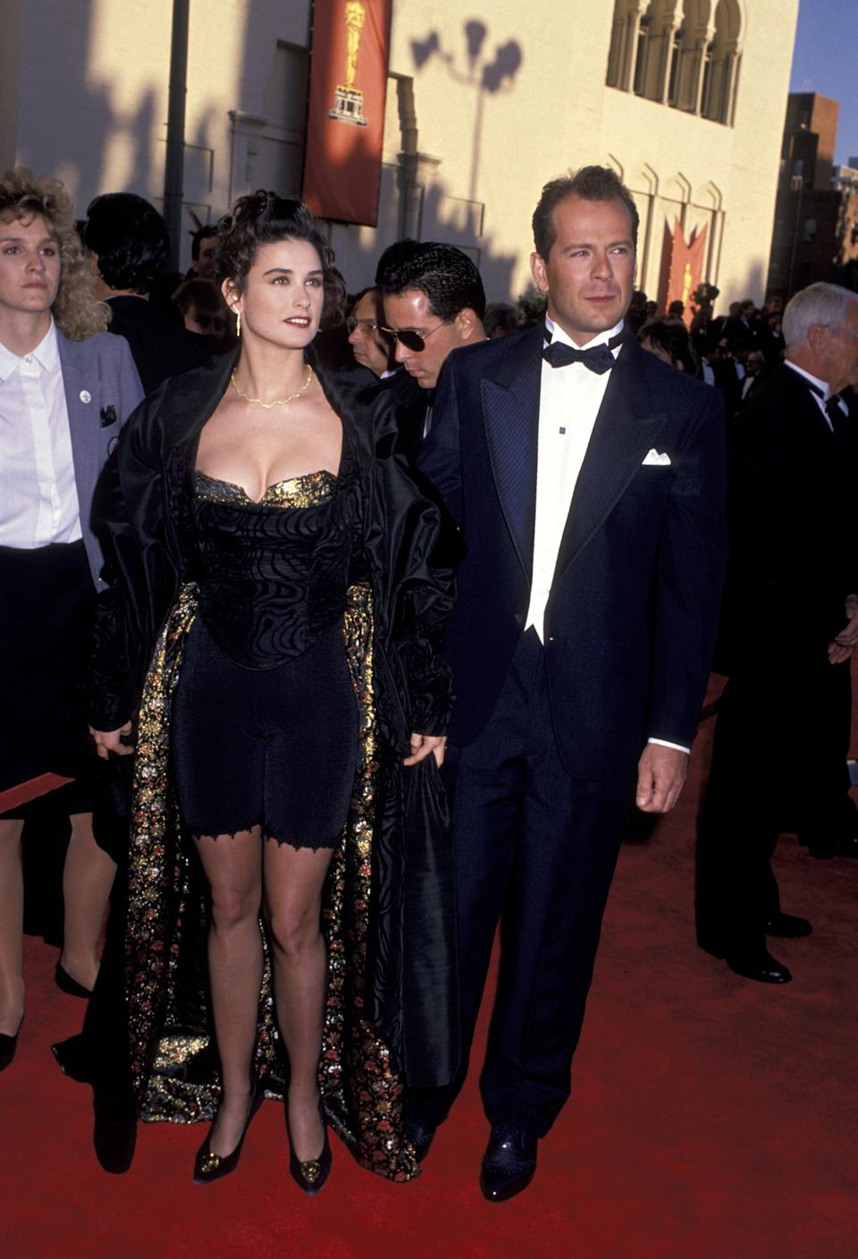 <p>Back in 1989, Moore decided to take matters into her own hands and fashion a look for the biggest red carpet in Hollywood herself. The actress paired a pair of spandex bicycle shorts with a corset and gold brocade fabric.</p>