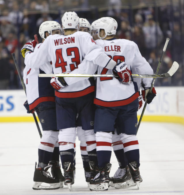 Washington Capitals celebrate a goal against the Columbus Blue Jackets during the third period of Game 4 of an NHL first-round hockey playoff series Thursday, April 19, 2018, in Columbus, Ohio. The Capitals won 4-1. (AP Photo/Jay LaPrete)